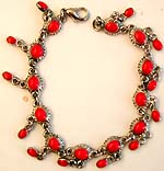 Fashion bracelet with multi horizontally lay oval shape red stone embedded