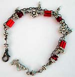 Flower motif double black chain fashion bracelet with red glass bugle beads connected