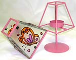 Lovely pink color table lamp style candle holder with painted flying butterfly figure on the cover