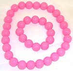 Multi rounded pink color plastic beads forming stretchy fashion necklace and bracelet set