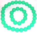 Multi rounded green plastic beads forming stretchy fashion necklace and bracelet set