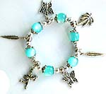 Blue beaded strecthy charm bracelet with butterfly, Apolo angel, and leaf pattern