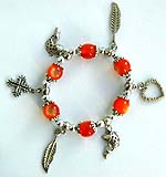 Orange beaded strecthy charm bracelet with cross, leaf fish and heart pattern