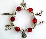 Red beaded strecthy charm bracelet with cross, leaf, dolphin and heart pattern
