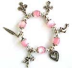 Pink color beaded strecthy charm bracelet with cross, leaf, dolphin, heart and Apolo angel pattern