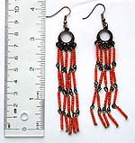 Fashion earring with metal ring shape pattern holding multi orange color beaded dangle
