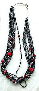 Tibetan style, tribe multi mini black beaded strings fashion necklace embedded with bigger red bead along the strings