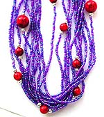 Tibetan style, tribe multi mini purple beaded strings fashion necklace embedded with bigger red bead along the strings