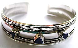 Sterling silver fashion bangle with assorted design lapis stone embedded in middle