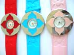 Embossed strap watch with round clock face and painting flower design