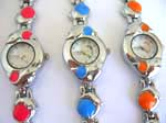 Double dolphin watch with round clock face and assorted color ball decor