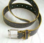 Black leather belt with golden beaded on top and bottom