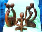 Assortment wooden abstract carving in genetic, yoga and kissing couple design